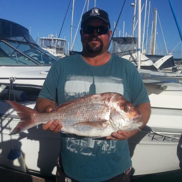 Catching fish on a Sunshine Coast reef fishing charter